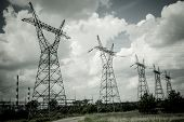stock photo of power transmission lines  - Pylon and transmission power line in summer day