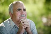 Elderly Man Sitting Thinking