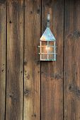 Old lantern on barn board
