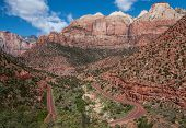 picture of semi-arid  - A scenic road descends a mountain side and loops back across a canyon floor in Zion National Park - JPG