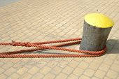 picture of bollard  - Hawsers attached to the bollard in harbour - JPG