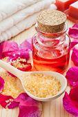 Oil In Glass Bottle, Sea Salt, Towel And Rose Petals