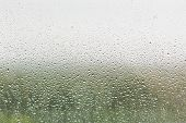 Raindrops On Home Window Glass