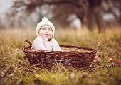 Happy little girl in basket