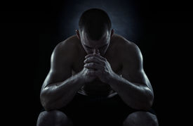 picture of strongman  - Close up of young sportsman focusing before the game isolated on black background - JPG