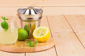 Lemon juicer with juice on wooden background