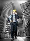Architect in protective helmet