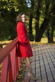 Woman At Autumn Park Relay On Boundaries
