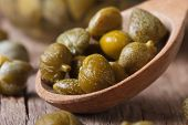 Ripe Capers In A Wooden Spoon Macro Horizontal