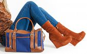 picture of platform shoes  - detail of sitting woman wearing fashionable platform brown shoes with a handbag - JPG