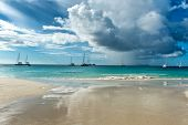 Scenic cloud formations over Anse Lazio Beach, Praslin, Seychelles with boats on the ocean in the background