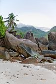 Old Large Rock Formations at the Beach of Mahe Island, Seychelles with White Beach Sand.