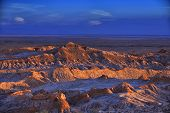 View to barren landscape of the Moon valley in Atacama desert at dusk, Chile. October, 10 2013