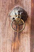 Thai Style Metal Lion Door Knocker On Wooden Door