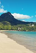 View from South Beach, Port Launay, Mahe of Morne Seychellois, the highest mountain peak on the island