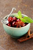 cherry compote with berries and spices anise, cinnamon