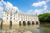 CHENONCEAUX FRANCE - JUN 15: Chateau de Chenonceau on June 15, 2014. Chateau de Chenonceau was built in 1514-1522 on the foundations of an old mill and was later extended to span the River Cher.