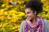 Young African American Woman Smiling Outdoors In Autumn