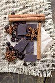 Chocolate Crumbs, Star Anise And Cinnamon Sticks.
