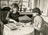 LODZ, POLAND, CIRCA SIXTIES - Vintage photo of two women playing