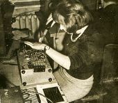 LODZ, POLAND, CIRCA SIXTIES - Vintage photo of woman working with a solder