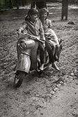 LODZ, POLAND, CIRCA SIXTIES - Vintage photo of young women on scooter
