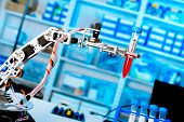 picture of robotics  - robot manipulates chemical tubes in the laboratory - JPG