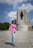 Girl On A Walk At The Memorial Statue
