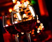 Two Red Wine Glass Against Christmas Lights Decoration Background