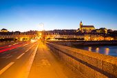 Cityscape of Blois with Cathedral over Loire river France at dusk