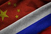 Flags Of China And Russia On Grunge Texture
