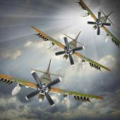 Dramatic scene on the sky. Old propeller planes inbound from sun. Retro technology background.
