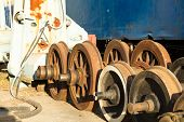 stock photo of train-wheel  - Old train wheels on metal storage  - JPG