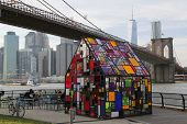 Stained glass sculpture by Tom Fruin under Brooklyn Bridge
