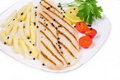 Grilled fish with fresh tomatoes and french fries