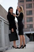 Two Attractive Hispanic Businesswomen Outdoor