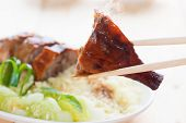 Peking Duck - Chinese roast crispy duck, close up with chopsticks. Fresh cooked with hot steam and smoke.