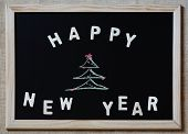Happy New Year Christmas Tree On Blackboard