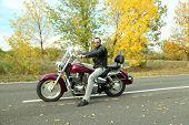 Biker man sits on bike