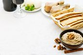 image of matzah  - Matzah wine eggs chicken greens and haroset on a white background traditional food for the Pesach - JPG
