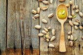 picture of sugar paste  - pistachio paste on a dark wood background - JPG
