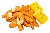 picture of sweet-corn  - Breaded chicken strips and potato wedges with sweet corn cobs isolated on a white background - JPG