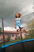 picture of bounce house  - Small cute child jumping on trampoline  - JPG