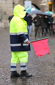 picture of policeman  - policeman in uniform with the red flag to signal the roadblock - JPG