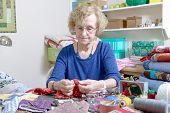 foto of quilt  - dressmaker working on her quilt in his workshop - JPG