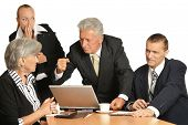 image of work crew  - Business people at work with laptop on a white background - JPG