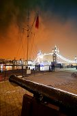 stock photo of cannon  - Cannon and Tower Bridge at night at St - JPG