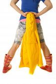 foto of woman boots  - a woman in her bright colored clothes and rain boots holding on to her raincoat behind her - JPG