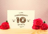 foto of carnations  - 10 years anniversary card with pink carnation flowers - JPG