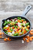 pic of lenten  - Mixed vegetable meal in old frying pan and ingredients on wooden rustic table - JPG